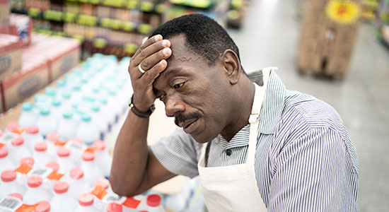 https-www-wisbar-org-sitecollectionimages-wisbarnews-grocery-store-worker-tired-upset-sad-anxious-550x300-jpg